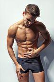Muscular Man Whis Abdominal Pain