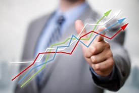pic of economy  - Businessman pointing to growth in a line graph showing business success - JPG