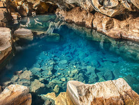 picture of incredible  - Volcanic cave Grjotagja with a incredibly blue and hot thermal water near lake Myvatn in the northeastern Iceland - JPG