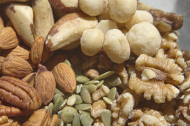 foto of brazil nut  - A close up of healthy raw organic nuts and seeds incuding walnuts almonds pumpkin seeds macademia nuts pecans and brazil nuts - JPG