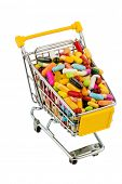 tablets with shopping cart. symbol photo for the purchase of medicines on the internet