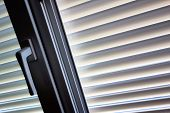 to protect against heat and sun blinds are attached to a window.