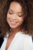 Studio Portrait Of Beautiful Woman Against Black Background