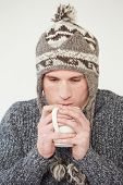 Studio Portrait Of Man With Hot Drink