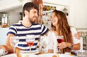 Young Couple Enjoying Meal In Outdoor Restaurant