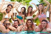 Portrait Of Friends Having Party In Swimming Pool