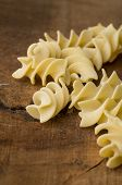 Italian eliche pasta macro on wooden table