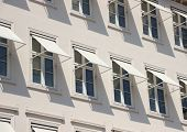 Closeup Perspective On Grey Building With  White Awning