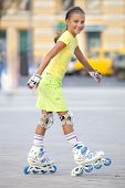 Girl on the roller blades.