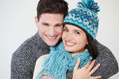 Studio Portrait Of Couple Wearing Warm Winter Clothes