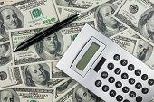 Pen,calculator And  Money  Close-up.