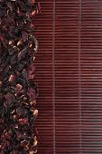 Dried Hibiscus On A Dark  Bamboo Mat