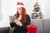 Girl Surfing Something For Christmas On The Tablet