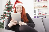 Girl Is Shopping Something For Christmas On The Tablet