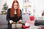 Young Girl Prepare Christmas Gifts