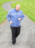 Overweight man running. Weight loss concept.