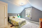 image of vault  - Light grey bedroom interior with vaulted ceiling and plank paneled walls - JPG