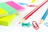 Multicolored stationery on white desktop closeup