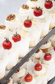 Little Cakes Decorated With Cherry Tomatoes And Walnuts