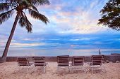 Chairs Beach Arrangement On Sand Location Against Beautiful Sun Rise And Colorful Sky Scene