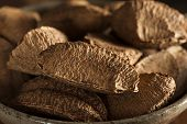 stock photo of brazil nut  - Organic Raw Whole Brazil Nuts in a Bowl