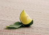 Lime with leaf lying on the desk