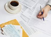 Businesswoman sitting on the desk with many documents