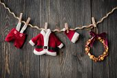 pic of clotheslines  - Santa Claus clothes and jewelry on the clothesline - JPG