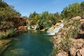 Small waterfalls near Tavira, a city in Algarve, Portugal, Europe