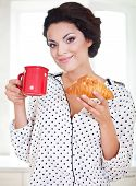 Happy Woman Holding A Cup Of Coffee And Croissant