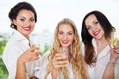 Bride To Be And Bridemaids Holding Glass With Champagne