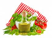 Olive Oil With Fresh Basil Leaves And Tomatoes Isolated On White