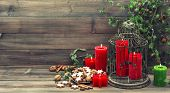 Christmas Decoration With Red Candles And Cinnamon Cookies