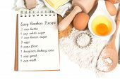 Постер, плакат: Recipe Book And Baking Ingredients Eggs Flour Sugar Butter Yeast