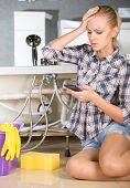 picture of plumbing  - Woman mopping up - JPG