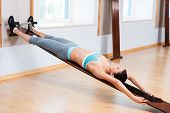 Woman Stretching In Gym.