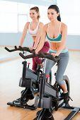 Women On Exercise Bikes.