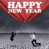 Asian Businessteam Drag New Year Banner