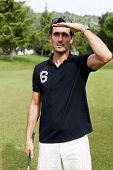 Professional golf player observe direction of ball