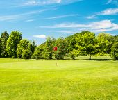 Green Field And Beautiful Blue Sky. Golf Course