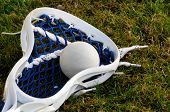 Lacrosse head with ball in netting