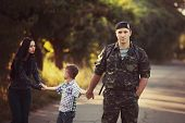 Family and soldier in a military uniform say goodbye before a separation