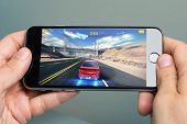 Hands Playing Asphalt 8 Game On Apple Iphone 6