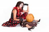 Sad Traveler with suitcase and pumpkin