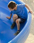 Child On Slide At Playground