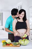 Man Kiss His Pregnant Wife