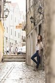 Beautiful Girl Waiting In A Historic Street