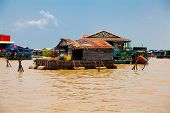 The Floating Village On The Water (komprongpok) Of Tonle Sap Lake. Cambodia.