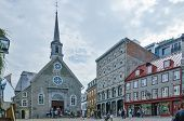 tourists visiting the old church in Quebec city