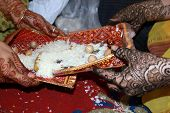 pic of mehendi  - Mehendi decorated Hands of two ladies during a traditional ritual performed in a Jain marriage - JPG